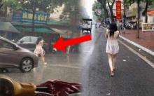 สาวสวยเดินเท้าเปล่ากลางถนน แถมฝนตกหนัก! พอจ้องใกล้ๆ รู้สาเหตุที่รถติด มองเหลียวหลังคอแทบหัก!!